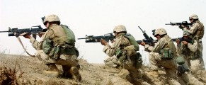 U.S. marines fire on a group of insurgents shortly after they launched a rocket propelled grenade at their 7-ton truck while on a 'movement-to-contact mission in order to flush out insurgents operating in the Fallujah area  south of Fallujah on Thursday, April 15, 2004 in Iraq.  The marines are part of the 3rd Battalion, 4th marine regiment, which saw heavy combat at the beginning of the war last year, and is now back in Iraq embroiled in intense fighting with the resistance.  Today, the men of the 3rd Battalion were ambushed half a dozen times while they patrolled the palm groves and wheat fields around fallujah, and the marines killed at least 10 insurgents, and suffered only minor injuries. (Credit: Lynsey Addario/ Corbis, for The New York Times)