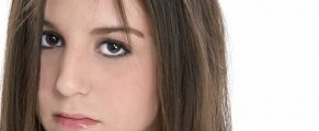 Close-up Sad Teen Girl.  Shot in studio over white with the Canon  20D.