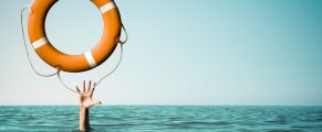 Drown man with rised hand getting lifebuoy help in sea or ocean