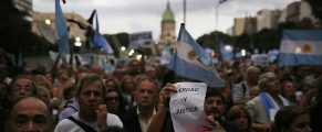 BUENOS AIRES, ARGENTINA - FEBRUARY 18:  Protestors attend a 'Silent March' marking the one-month anniversary of the suspicious death of special prosecutor Alberto Nisman on February 18, 2015 in Buenos Aires, Argentina. Nisman was discovered dead with a gunshot wound shortly before he was scheduled to present accusations against President Cristina Fernandez de Kirchner. (Photo by Mario Tama/Getty Images)